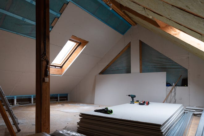 A popular, cost-effective way to add space without actually adding on is by going up into the attic.