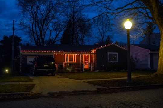 A home in the Groesbeck neighborhood decorated with Christmas lights on Tuesday, March 24, 2020, in Lansing.