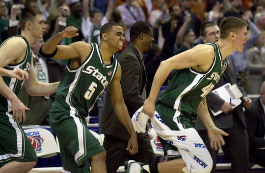 MSU's Erazem Lorbek, Chris Hill and Paul Davis , left to right, celebrate as the run onto the court after MSU's Sweet 16 victory over Maryland in 2003.