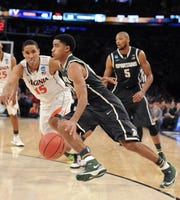 MSU's Gary Harris drives  against Virginia's Malcolm Brogdon during their Sweet 16 on March 28, 2014 at Madison Square Garden. The fourth-seeded Spartans, beat top-seed Virginia, 61-59.