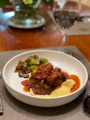 Braised short ribs over stone-ground grits.