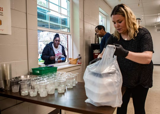 Volunteers prepare grab-and-go meals at Caritas Community Center and Cafe in Binghampton on Tuesday, March 24, 2020. Caritas Community Center and Cafe offers free daily meals to out-of-work Memphians.