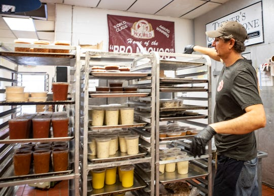 John O'Boern prepares to-go orders at Hog Wild at 1291 Tully St. on Friday, March 20, 2020.