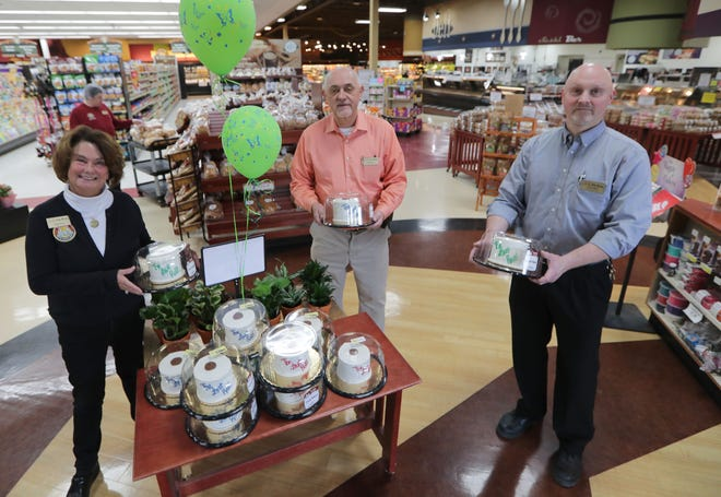 (From left) Lori Fox and her husband Pat Fox, who oversee an employee-owned chain of nine Piggly Wiggly stores, with Chris Staff, store director, hold mini cakes in the shape of toilet paper rolls made at the store as a lighthearted way to deal with the shortage of toilet paper due to the coronavirus at Fox Brothers Piggly Wiggly in Hartland in March. Lori and Pat Fox are transitioning to smaller roles at the company, part of a pre-arranged succession plan. Photo by MIKE DE SISTI / MILWAUKEE JOURNAL SENTINEL