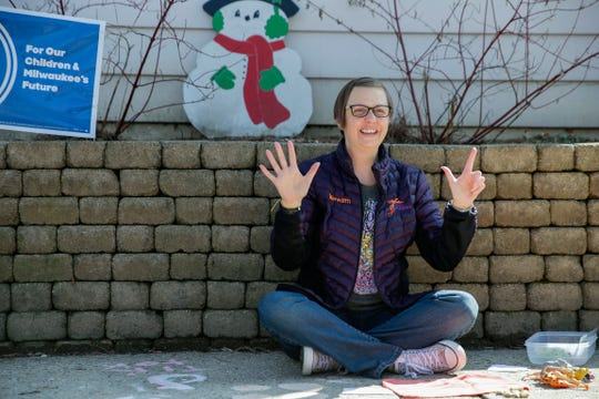 Meredith Grob Polewski records a video for her students in front of her house on Wednesday, March 25, 2020. Grob Polewski is a K4 teacher. She started recording lessons for her students last week when they were told they couldn't go back to the classroom.
