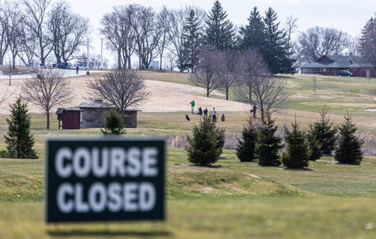 "Golfers at Moor Downs Golf Course in Waukesha ignore Gov. Tony Evers' ""Safer At Home"" order on Wednesday, March 25, 2020. Evers' order mandated all nonessential businesses, including golf courses, around the state to close during the pandemic. The order went into effect at 8 a.m. Wednesday, March 25 and will remain in effect until 8 a.m. on April 24."