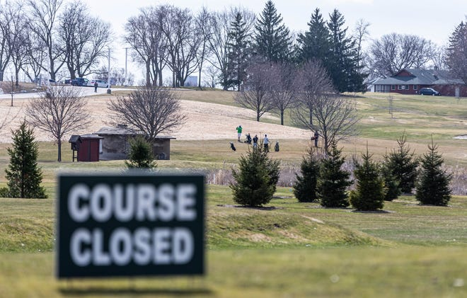 "Golfers at Moor Downs Golf Course in Waukesha ignore Gov. Tony Evers' ""Safer At Home"" order March 25. Evers' order mandated all nonessential businesses, including golf courses, around the state to close during the pandemic. The order went into effect that day."
