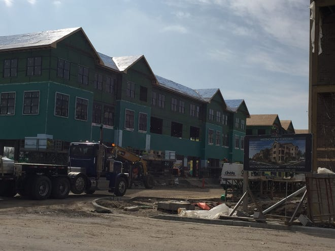 Work is continuing at dozens of Milwaukee-area construction sites, including apartments at the Foxtown mixed-use project in Mequon.