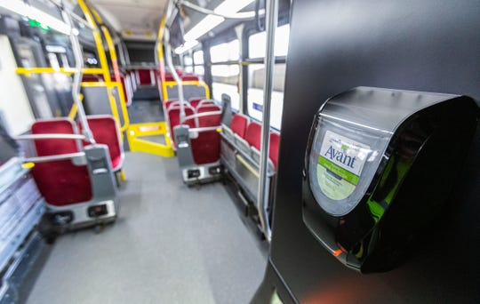 Amid the coronavirus pandemic, Waukesha Metro Transit is providing free bus rides and implemented new boarding procedures (using rear door only) for passengers. A hand sanitizer dispenser is located on each bus as seen on Wednesday, March 25, 2020 and nightly deep cleaning is occurring as well.