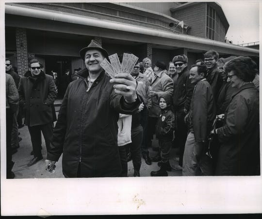 Donald Hebbe of Milwaukee shows off his tickets for the Brewers' first opening day in 1970. He waited in line for an hour and a half.