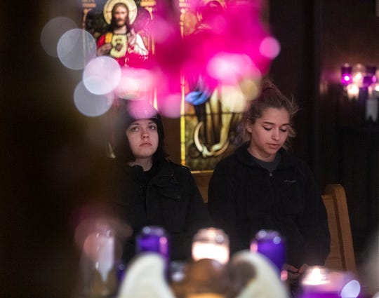 Danielle Fameree, right, prays Tuesday while accompanied by her sister, Danae, in the small Apparition Oratory for prayer on the lower level of the chapel at the National Shrine of Our Lady of Good Help.