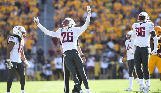 In this Oct. 12, 2019, photo, Washington State defensive back Bryce Beekman (26) reacts after he stopped Arizona State running back A.J. Carter for a one yard loss during the second half of a game at Sun Devil Stadium in Tempe, Ariz.
