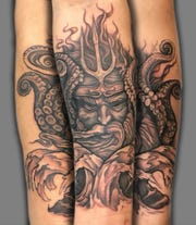 """Todd Gnacinskiof Positronic Tattoo in Shorewood described his tattooing style as """"illustrative"""" and painterly."""""""