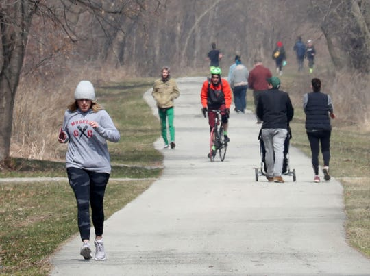People walk, jog and bike on the Oak Leaf Trail near downtown Milwaukee on March 25. It could be a similar scene in Greenfield in the coming years. The city has received a $1.2 million federal grant to design and build the first phase of the Powerline Trail, a 3-mile segment of paved, east-west trail that will stretch from the Oak Leaf Trail at 105th Street and Cold Spring Road to 60th Street.