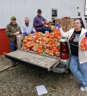 The Norfork Fire Department assisted the North Arkansas Food Bank distribute bags of oranges Wednesday throughout the community.