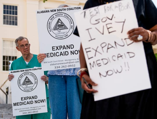 Members of the Save OurSelves Movement for Justice and Democracy hold a press conference on the steps of the State Capitol Building in Montgomery, Ala., on Wednesday March 25, 2020 asking state leaders to approve expansion of Medicaid in Alabama.