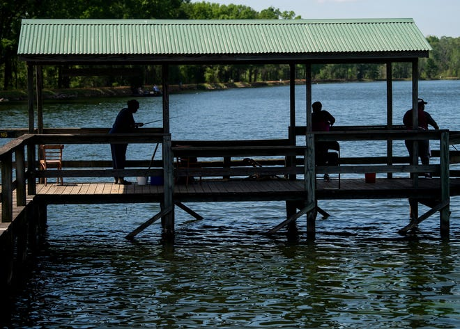 Guest keep their distance as they fish at Dallas County Lake  in Sardis, Ala., on Wednesday, March 25, 2020.