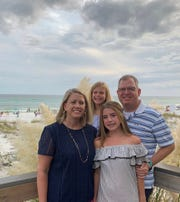 Glenn Adams (right) and Jennifer Adams in a family photograph with their daughters Harper (bottom) and Spencer. Glenn Adams, a director of product management for a San Antonio-based company, has tested positive for COVID-19