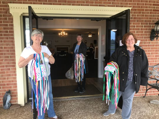 Senior Activity Center of Smyrna members, from  left, Shirley McIntire, Peggy Massey and Jackie Vaughan hold 50 masks that will be delivered to medical personnel.
