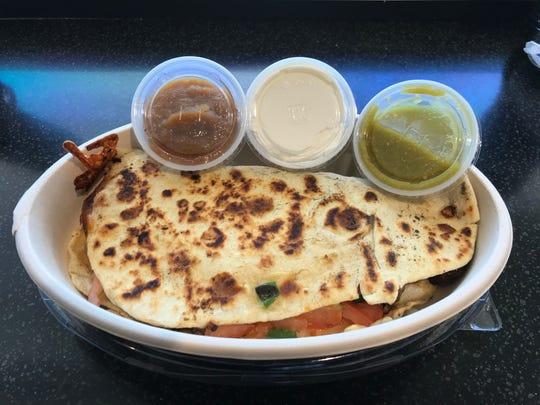 A quesadilla from Laredo Taco Company fills the plate.