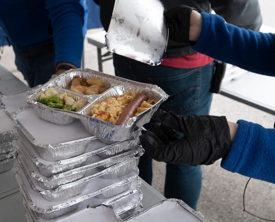 Staff at Room in the Inn prepare to deliver lunches to  the homeless outside their facility Wednesday, March 25, 2020 in Nashville, Tenn. During the Coronavirus outbreak the Room in the Inn is limiting the number of guests or clients into their facilities.