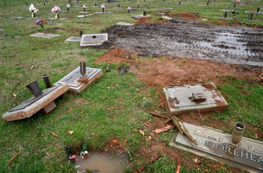 Grave markers that appear to have been moved during tornado recovery in Wilson County Memorial Park in Lebanon, Tenn. Monday, March 23, 2020.