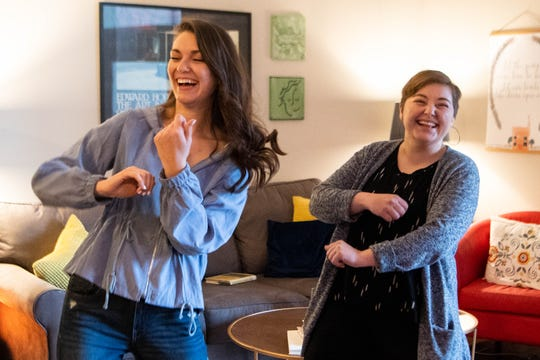 Katie Clinebell, left, and Ellen Wildman record themselves dancing to put on Instagram at their home Tuesday, March 24, 2020, in Brentwood, Tenn.