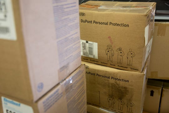 Boxes of personal protective clothing are organized to be donated to NCH at the Benison Center warehouse in Immokalee on Wednesday, March 25, 2020.