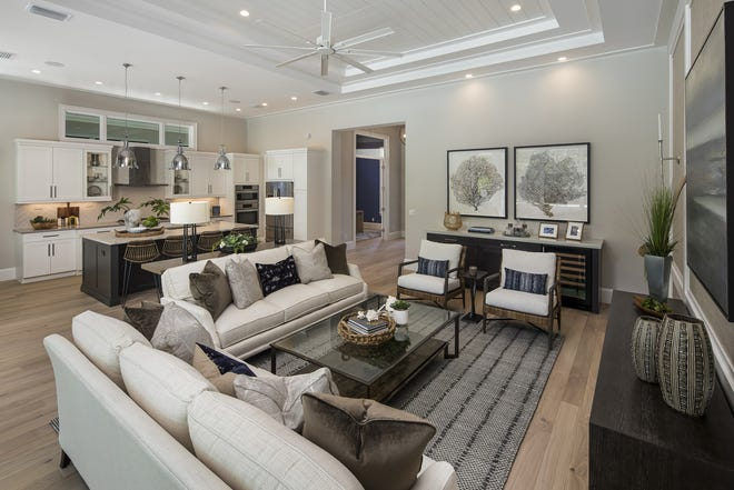The Cayman II model is one of three models open for viewing and purchase at Windward Isle, a gated enclave of 28 single-family homes being developed by Seagate Development Group.