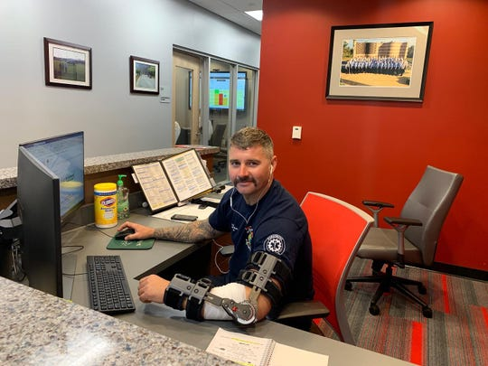 Lt. Mike Moore, of the Naples Fire-Rescue Department, works the city's coronavirus hotline.