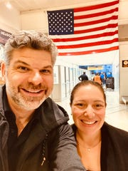 Laura and Gregg Arst, returning to Newark Airport after initially being stranded on an expedition ship in Argentina.