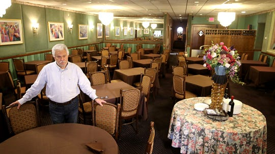 Manny Moreira, in the empty dining room of Nanni Ristorante of Rochelle Park, NJ on March 25, 2020. His restaurant is empty due to the shutdown from the effects of the corona virus outbreak. Business is down 95% says owner Manny Moreira as they can only sell take out.