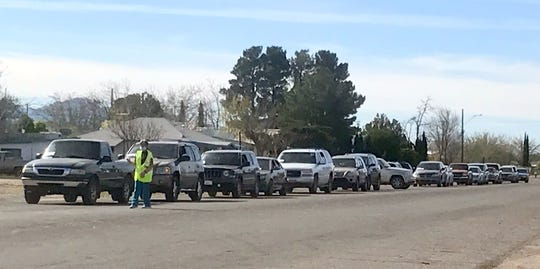 South Diamond Street was lined with vehicles early Wednesday morning waiting the food distribution center at Santa Ana Catholic Church to begin handing out food boxes for families in need. The lined of vehicles backed up traffic south to Cody Road.