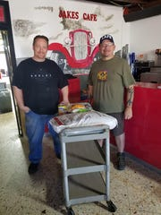 Jacob Harkness, left, owner of Jake's Cafe, and Jeremiah Richardson, right, have partnered together to deliver meals to the elderly and disabled starting on Monday, March 30, 2020.
