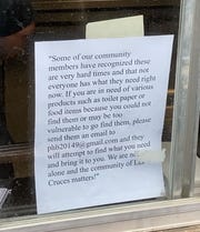 A flyer at Milagro Coffee Y Espresso, 1733 E. University Ave., posted by Dr. Zooey Sophia Pook, a professor at New Mexico State University, offers to deliver items to people in need such as toilet paper and food.