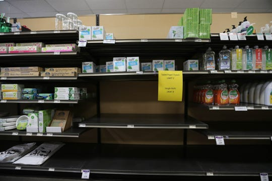 Toilet paper is absent from the shelves at Mountain View Market Co+op in Las Cruces on Friday, March 20, 2020.