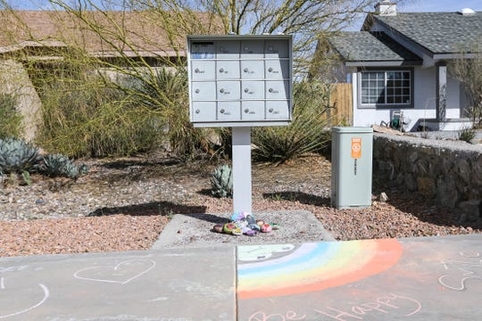 Kaitlyn Sponseller draws with chalk to brighten her neighbor's day in Las Cruces on Wednesday, March 25, 2020.