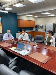 From left: Artesia General Hospital staff members, David McEachern, Dr. Marshall Baca Jr. and Kim Salgado participate in a teleconference call March 25, 2020 addressing the death of a COVID-19 patient.