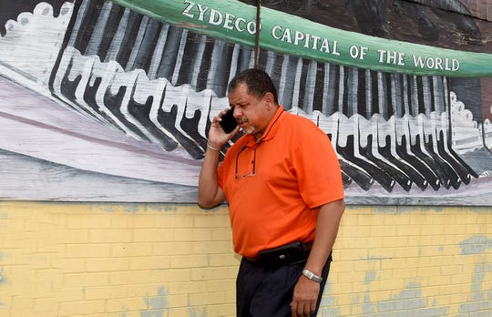 Opelousas Mayor Julius Alsandor takes a call as he arrives at Opelousas City Hall Wednesday morning.