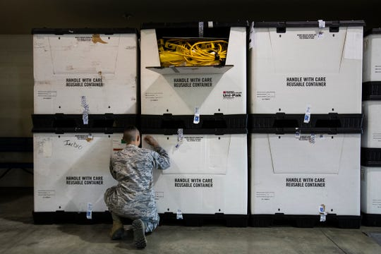 Members of the United States National Guard  help set up a 125-bed temporary hospital to be used for COVID-19 patients  at the Riverside County Fair & National Date Festival grounds in Indio, California to be used for COVID-19 patients.