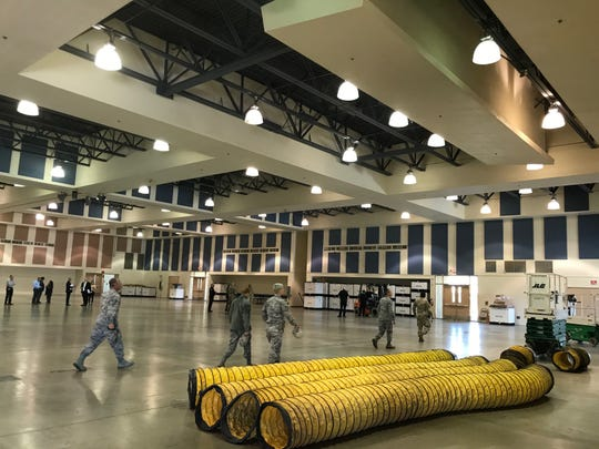 The California National Guard building a 125-bed federal medical station inside an existing Indio fairgrounds building. The station will include beds, sheets, portable sinks, medication and personal protective equipment, such as masks, gloves and gowns, according to Riverside County. (March 25, 2020)