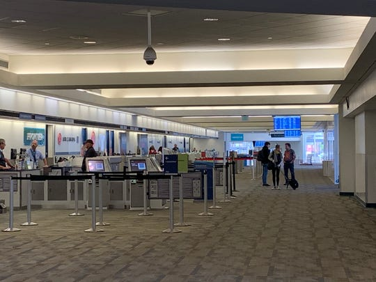 Few people are present at Palm Springs International Airport Wednesday, March 25, 2020. Officials say coronavirus has reduced traveling and airports across the country are filled with empty terminals.