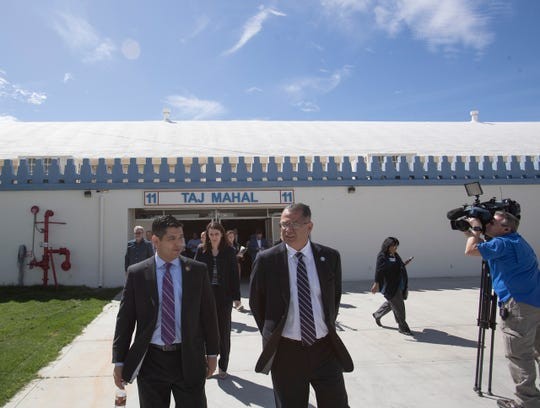 At left, U.S. congressman Raul Ruiz and Riverside County Supervisor V. Manuel Perez walk at the Riverside County Fair & National Date Festival grounds in Indio, California to observe the creation of a 125-bed temporary hospital to be used for COVID-19 patients in the Coachella Valley.