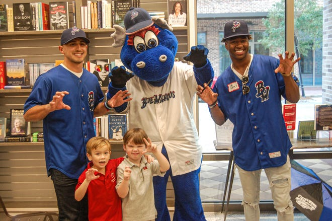Two Minnesota Twins prospects, Mark Contreras, far left, who played for Blue Wahoos last season, along with Willie Joe Gary, far light, join Kazoo with children at Bodacious Bookstore during Twins Pensacola Caravan on Jan. 20.