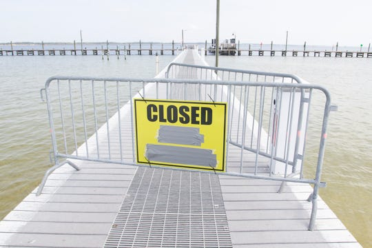 The dock at Quietwater Beach are closed as the Pensacola Bay Cruises operations have ceased until further notice at the Pensacola Beach Boardwalk on Wednesday, March 25, 2020.  Some businesses on the boardwalk remain open while others are closed during the coronavirus pandemic.