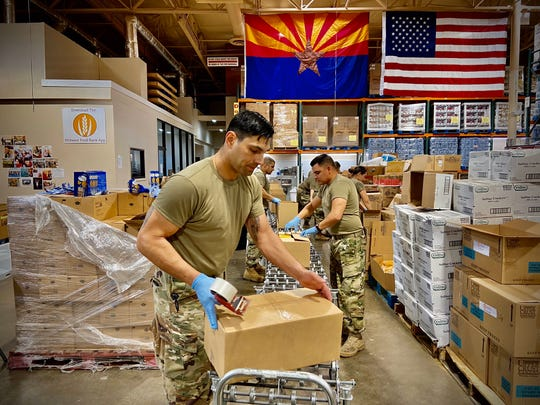 The National Guard packaging food at Midwest Food Bank in Gilbert