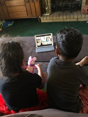 Nashla Naranjo, 4, and her brother Topher, 7, participate in a virtual show-and-tell with Nashla's pre-K class on March 24, 2020.