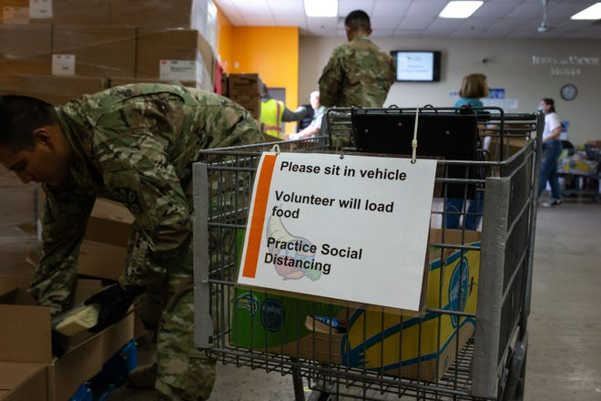Arizona Army National Guard members assemble food boxes on March 25, 2020, at the St. Mary's Food Bank Alliance in Phoenix.