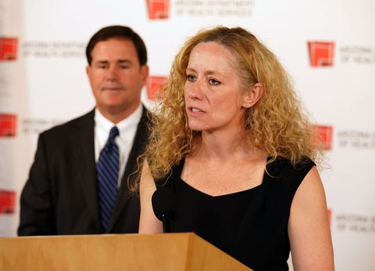 Arizona Department of Health Services Director Dr. Cara Christ joins Gov. Doug Ducey at a press conference in Phoenix on March 25, 2020, to update the public about Arizona's preparedness for the COVID-19 outbreak.