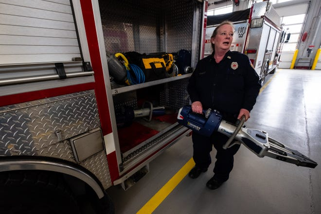 Fort Gratiot Firefighter?EMT Deb Nichols-Jurek lifts the jaws of life out of a compartment on a firetruck Tuesday, March 3, 2020, at Fort Gratiot Fire Department.